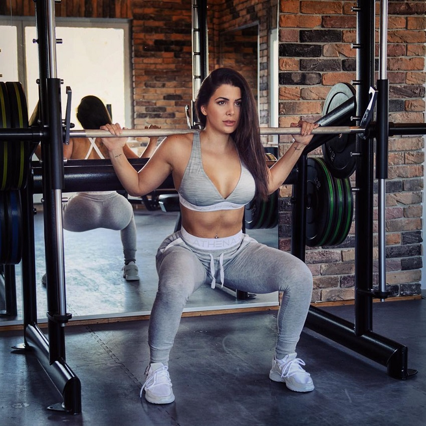 Andrina Santoro doing smith machine squats looking healthy and fit