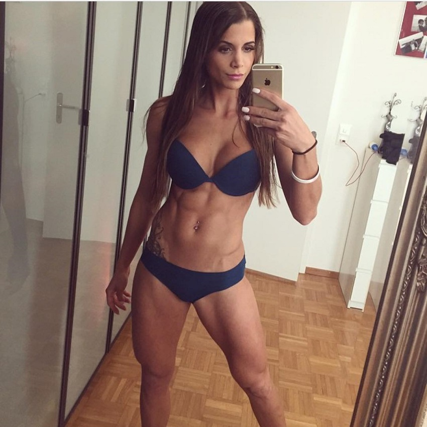 Andrina Santoro taking a selfie of her ripped physique