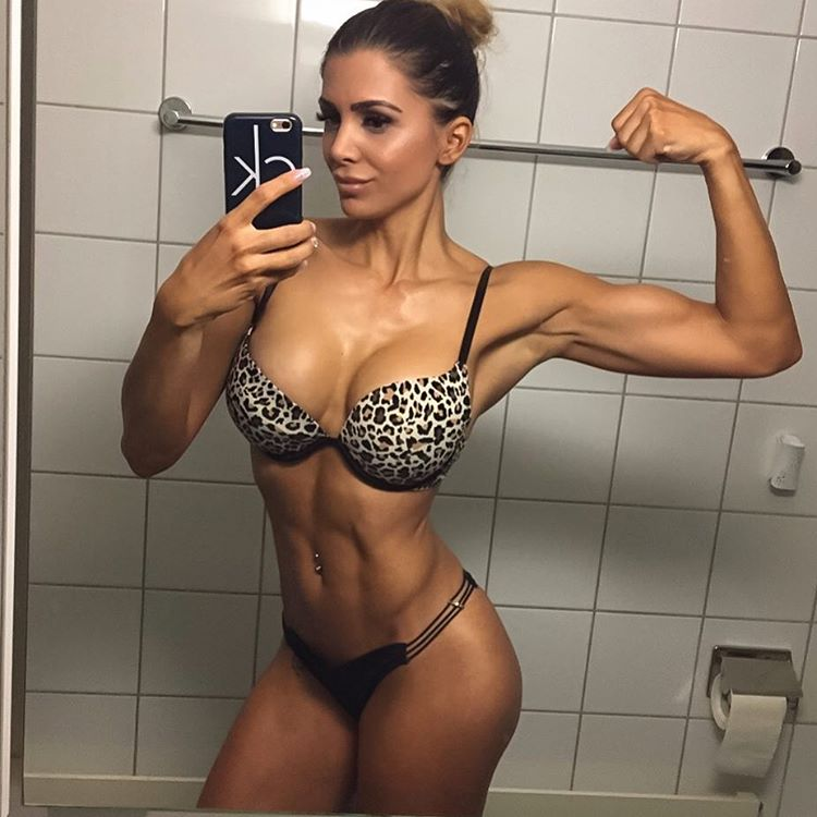 Andrina Santoro taking a selfie of her lean figure