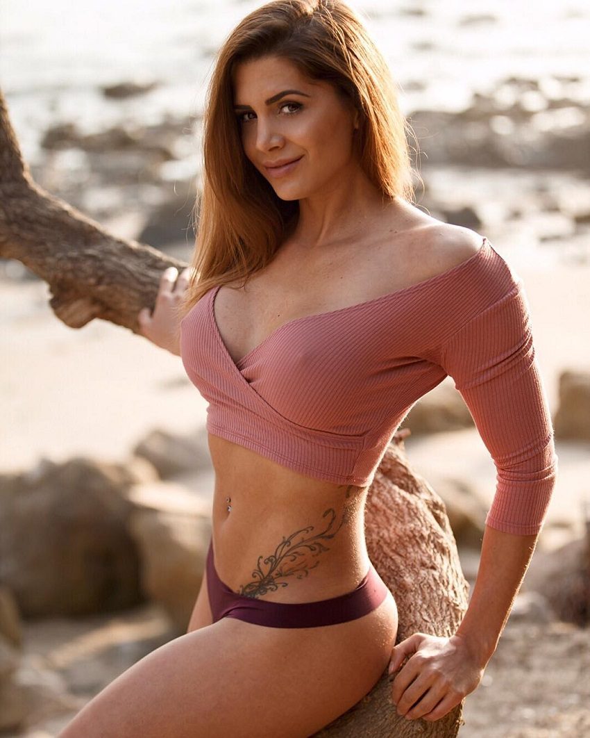 Andrina Santoro standing on the beach looking fit and curvy