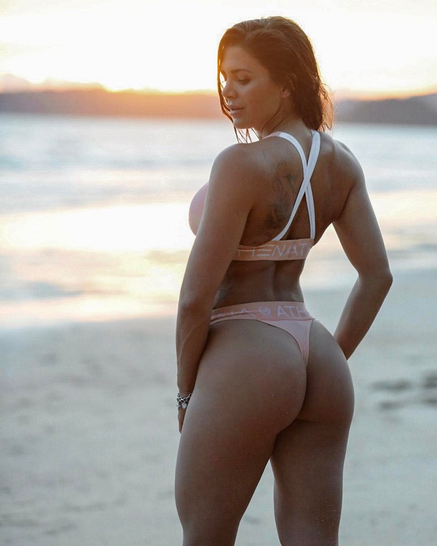 Andrina Santoro posing on the beach looking fit and curvy