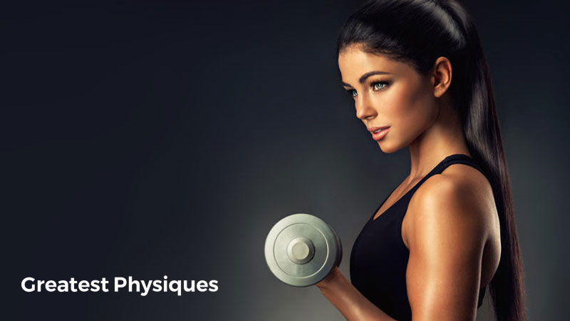Tanned, beautiful female athlete lifting a dumbbell on a black background