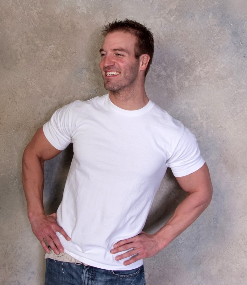Ben Booker posing for a photo in a white t-shirt looking lean and healthy