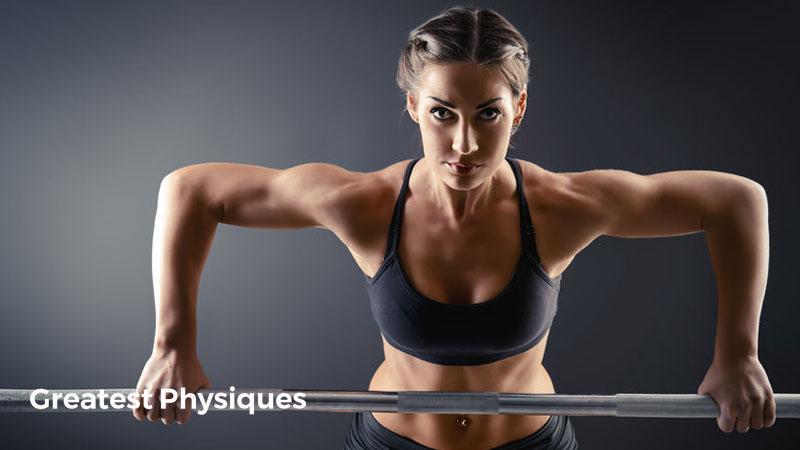 Strong female athlete in sportswear performing a bent over row on a grey background