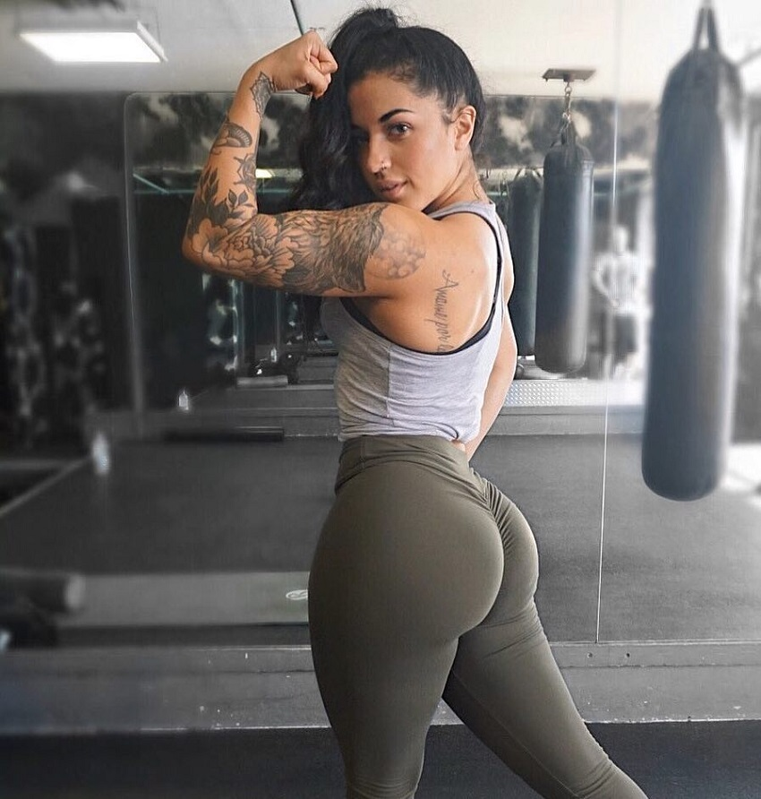 Bianca Taylor flexing her biceps for a photo