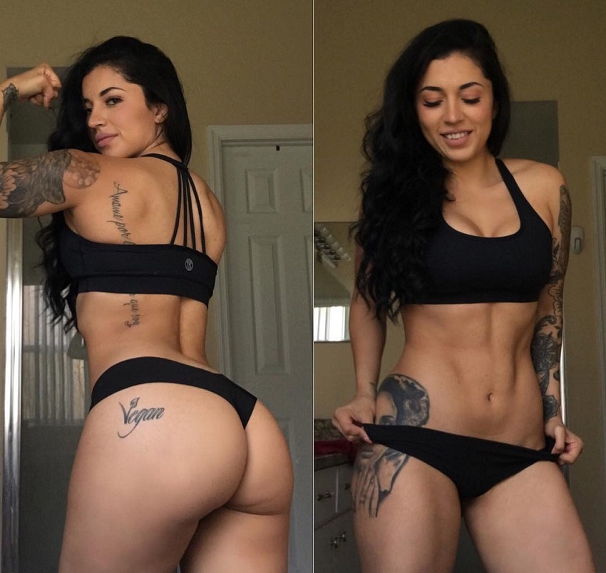 Bianca Taylor flexing her muscles for a photo looking curvy and lean