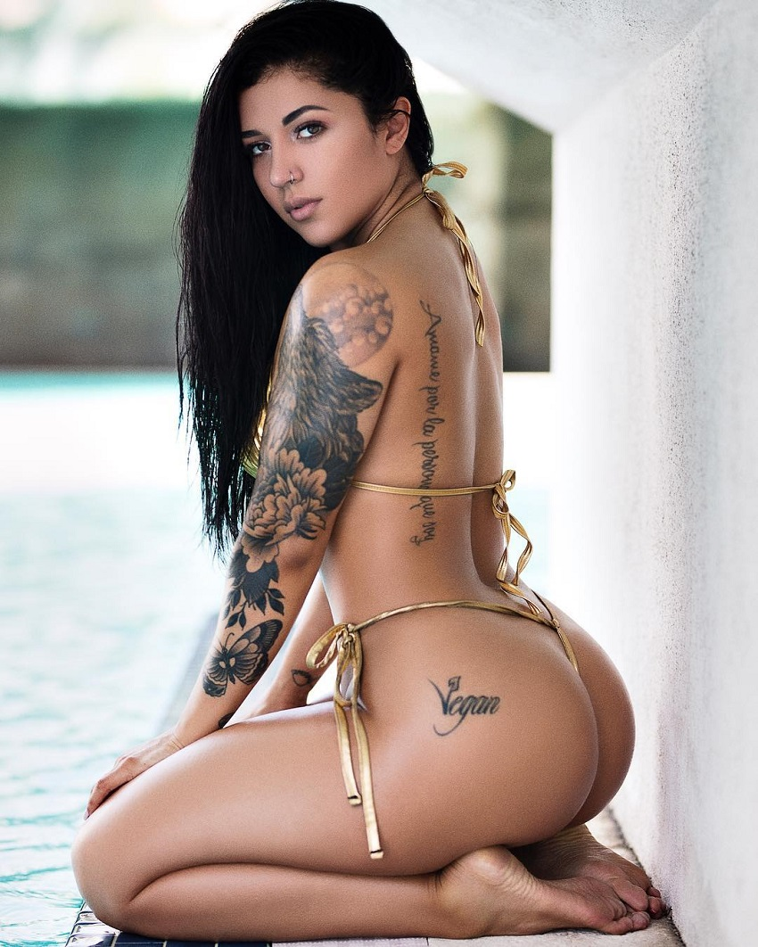 Bianca Taylor in a photo shoot showing off her curvy and tatooed physique
