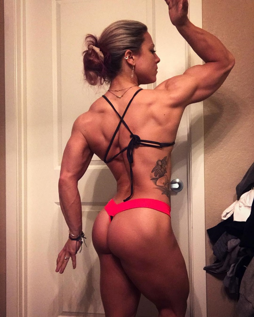 Dani Reardon showing off her physique from the back for a photo