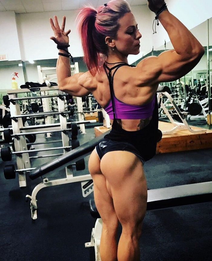 Dani Reardon flexing her back, legs and glutes for a photo