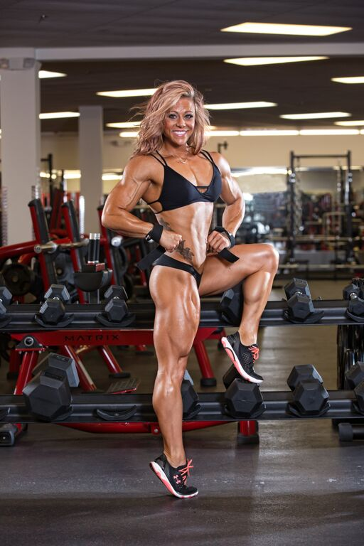 Dani Reardon posing in a photo shoot looking lean, fit, and healthy