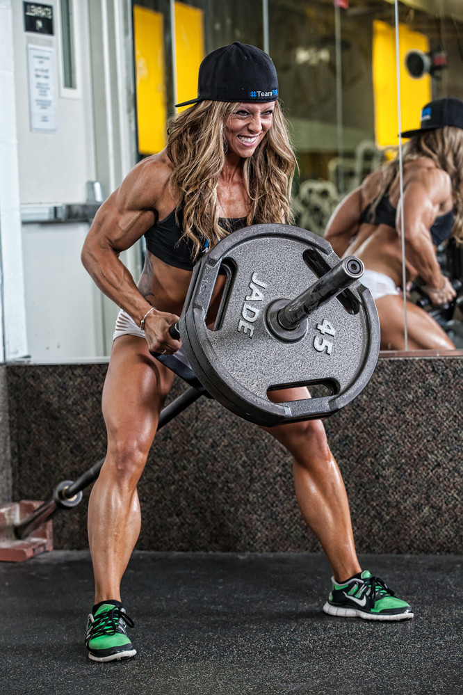 Dani Reardon doing t-bar rows looking muscular and ripped