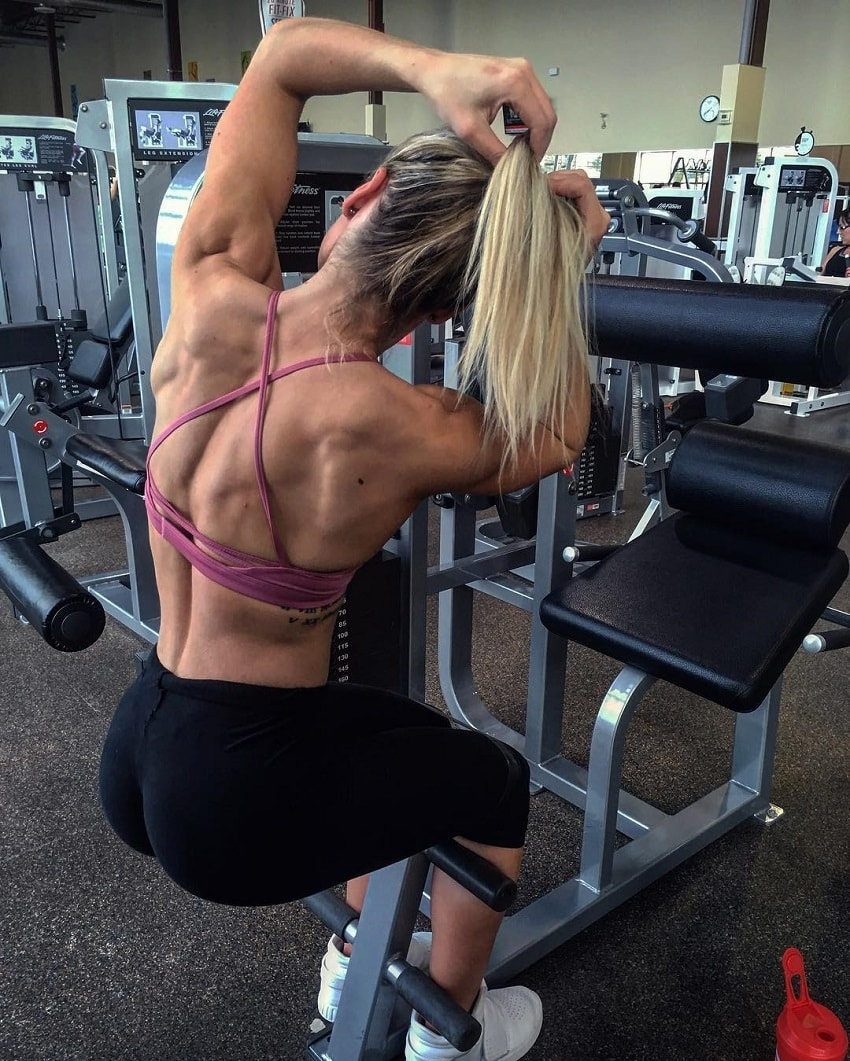 Destiny Stephens showing off her muscular back in a gym