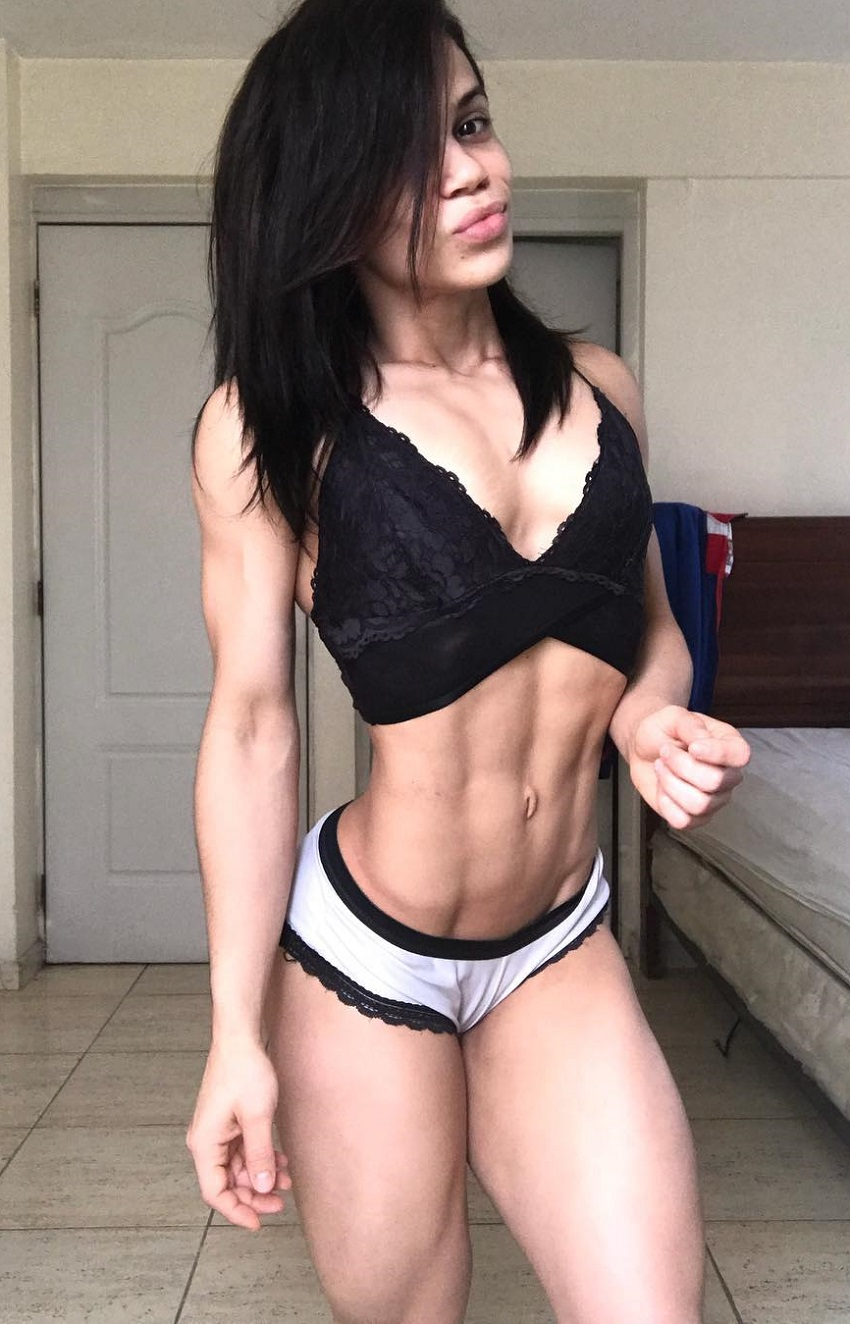Elba Peka posing for a photo in her room looking lean and healthy