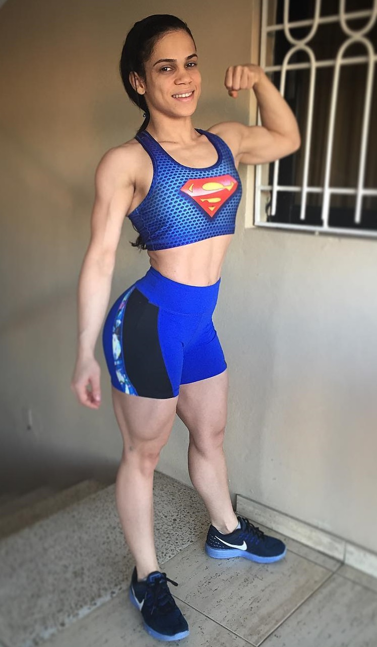 Elba Peka flexing her muscles for a photo looking fit