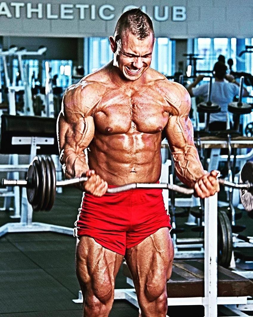 Matt Porter doing heavy biceps barbell curls