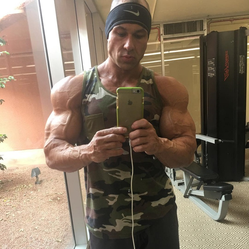 Matt Porter taking a selfie of his ripped and muscular arms