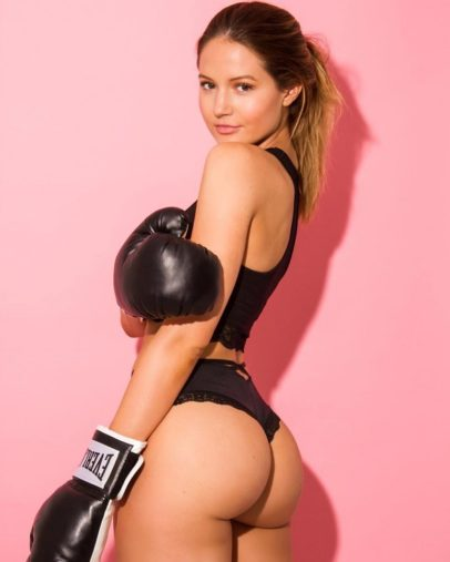 Summer Lynn Hart posing in a photo shoot wearing boxing gloves showing off her curvy glutes