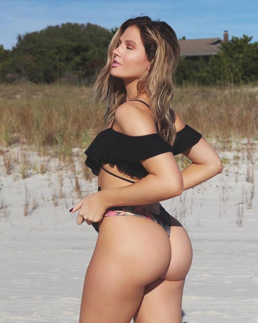 Summer Lynn Hart displaying her curvy glutes on a beach