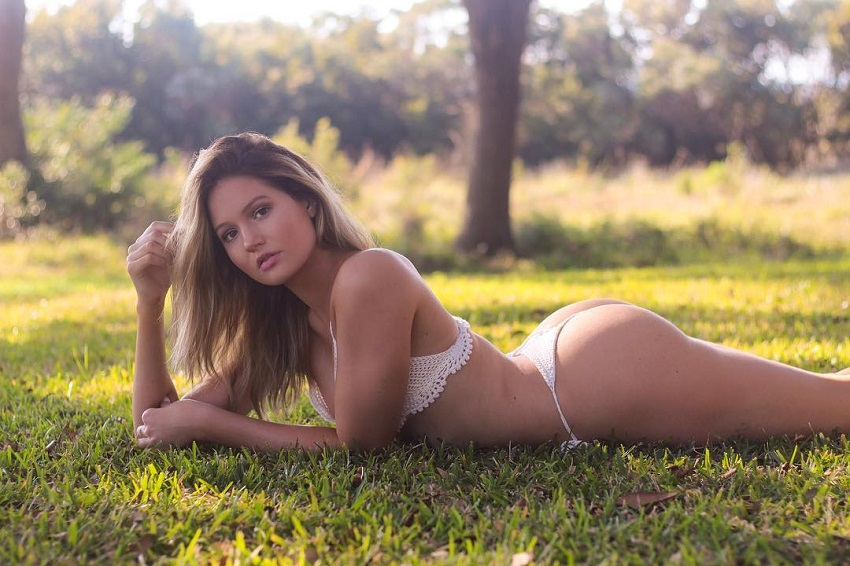 Summer Lynn Hart lying in the grass looking fit