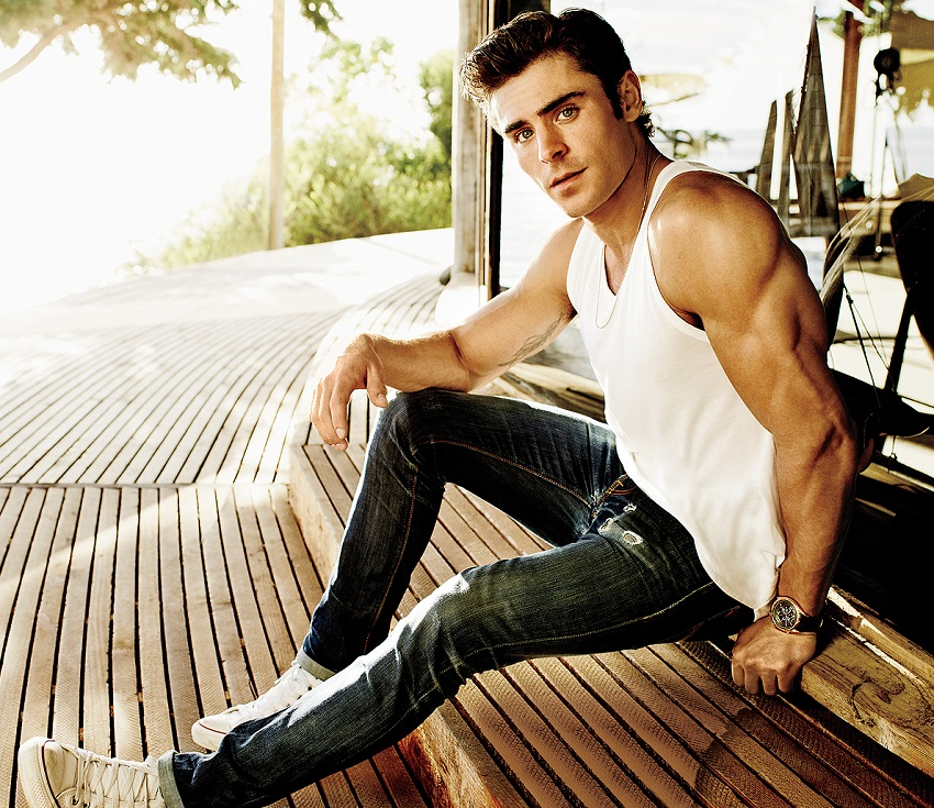 901e8dcedc06a2 Zac Efron posing for a photo in white tank top looking fit and lean. ""