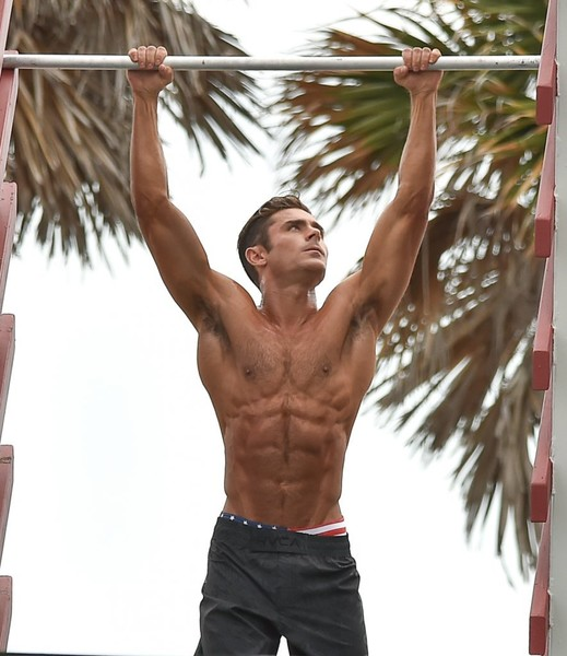 Zac Efron doing pulls ups, looking ripped and healthy