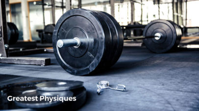 Barbells and weight plates on the floor of a crossfit gym