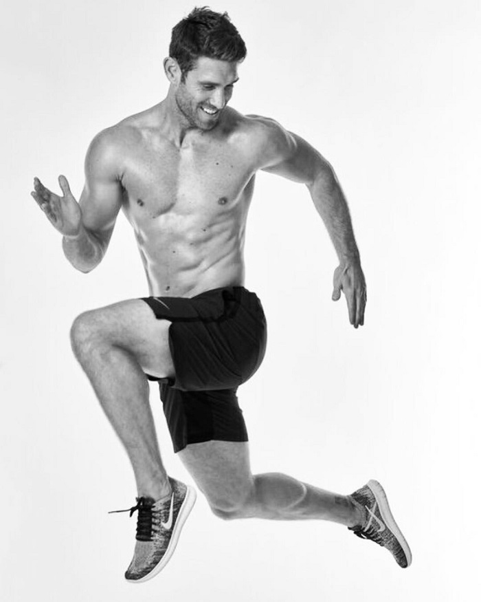 CJ Koegel in a running pose during a photo shoot looking fit and lean