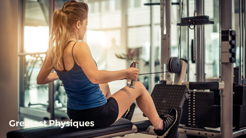 Young female athlete performing a low cable row in the gym to get fitter