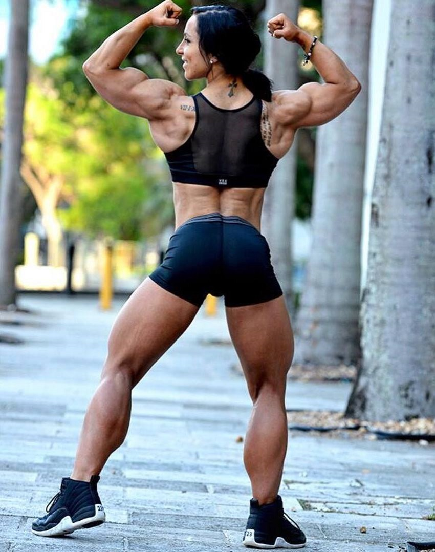 Chloe Sannito doing a back double biceps pose for a photo looking strong and muscular