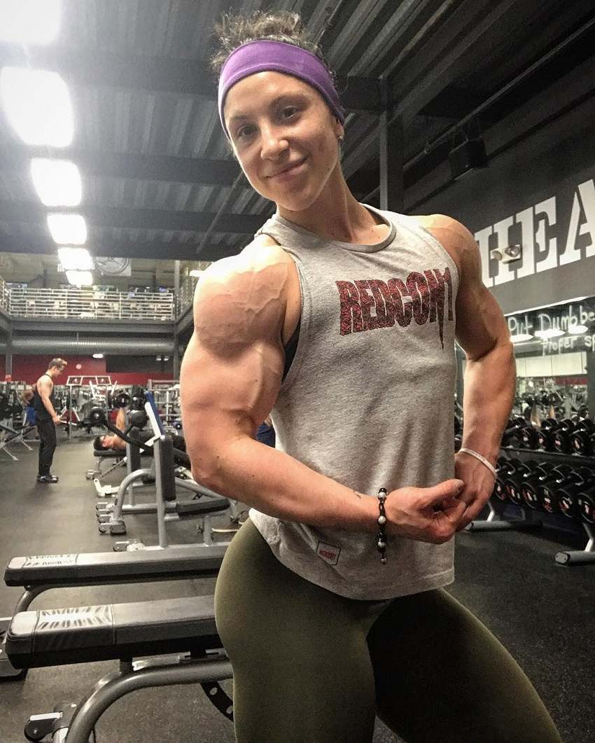 Chloe Sannito flexing her incredibly vascular and ripped arms and shoulders