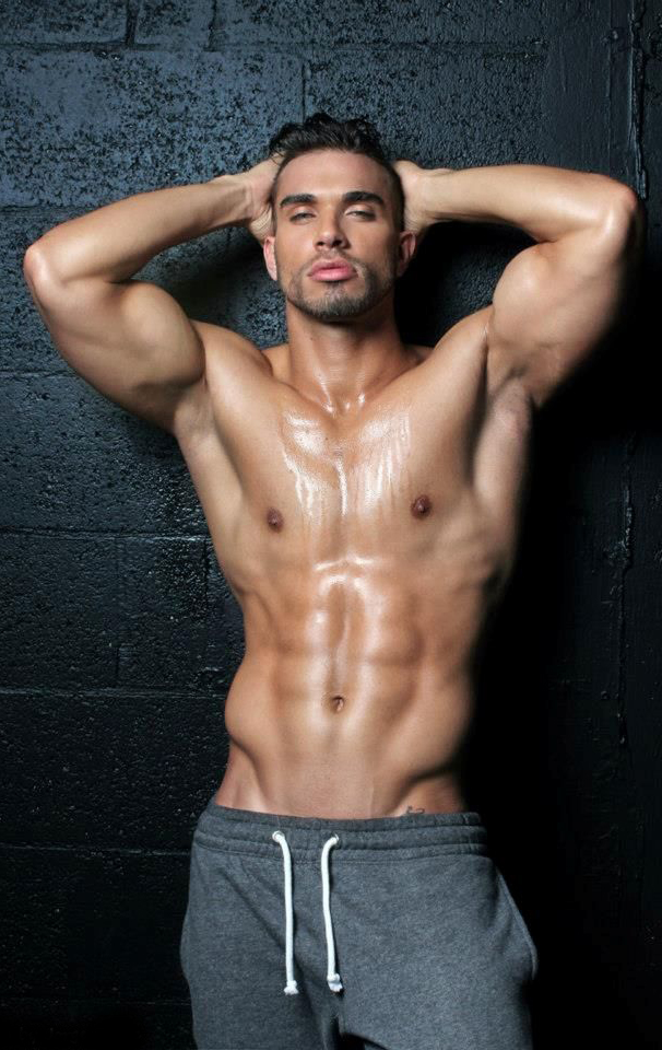 Darian Alvarez flexing his ripped abs for a modelling photo shoot