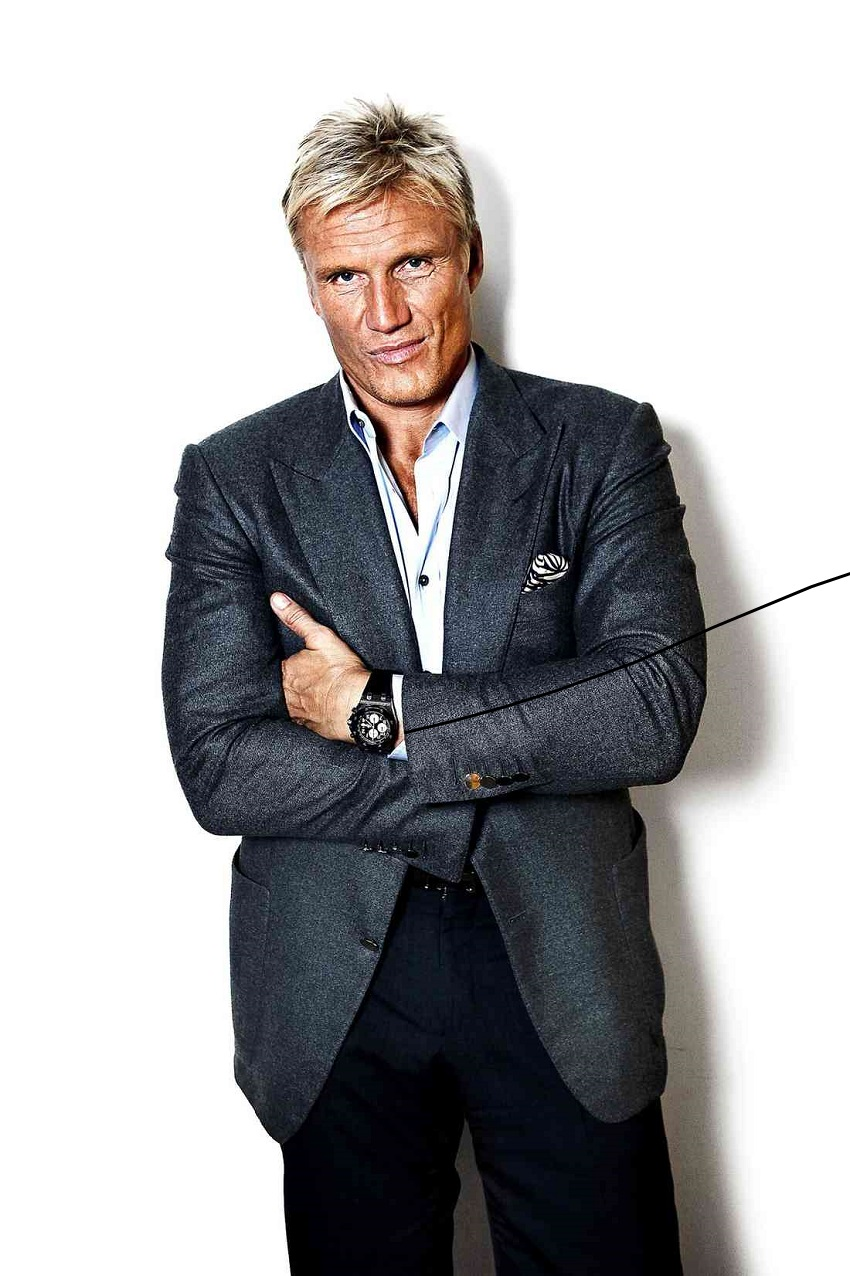 Dolph Lundgren in a classy suit looking healthy and strong