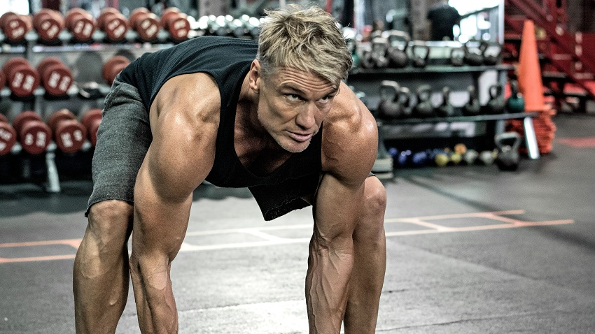 Dolph Lundgren training heavy in a gym looking strong and fit