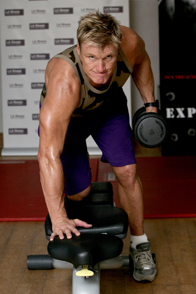 Dolph Lundgren doing dumbbell lat rows looking fit and lean