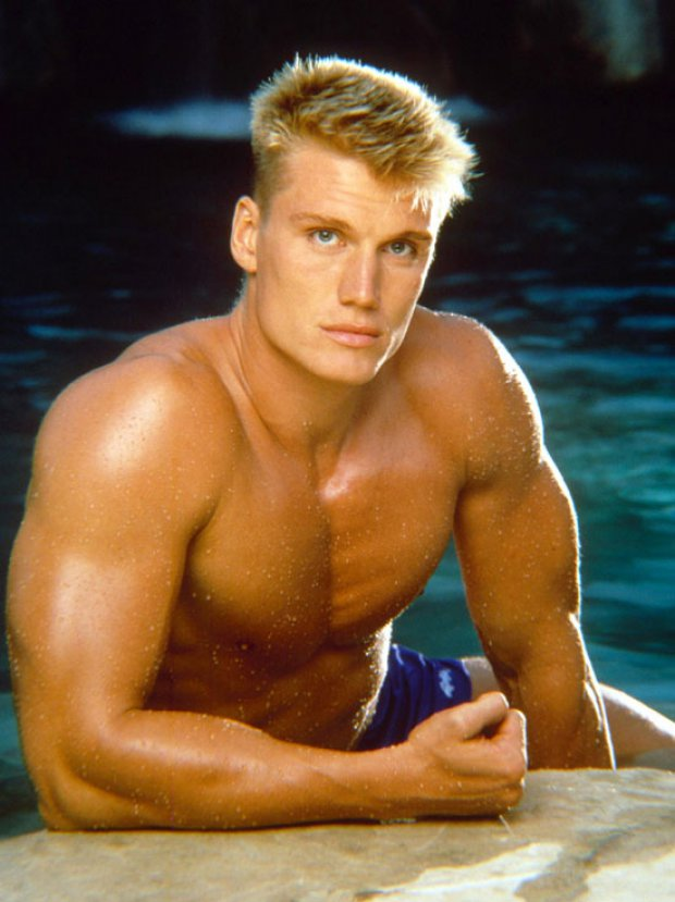 Dolph Lundgren posing shirtless in a photo looking lean and fit