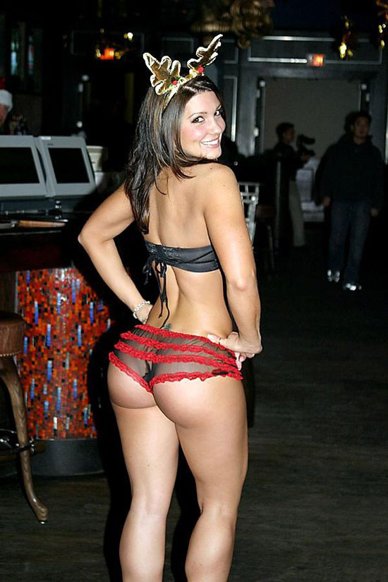 Gina Carano showcasing her curvy glutes in a photo