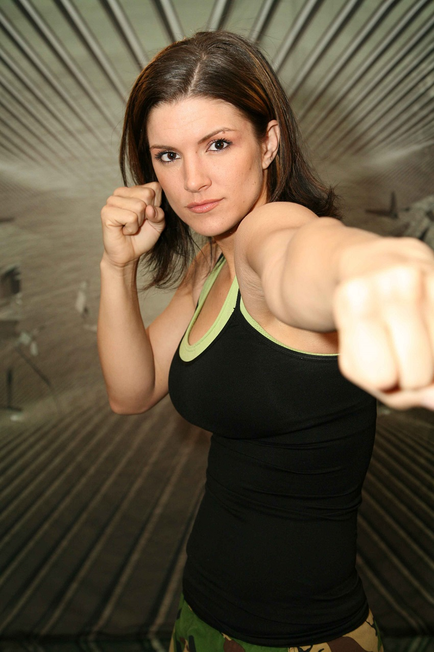 Gina Carano standing in a boxing stance looking directly at the camera