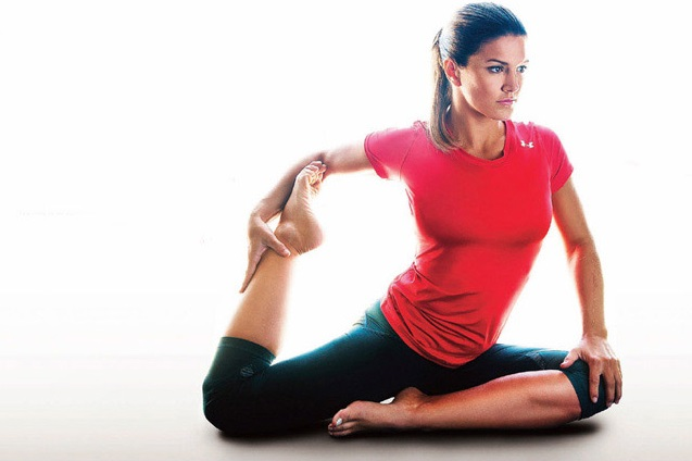Gina Carano stretching her lean and fit leg muscles