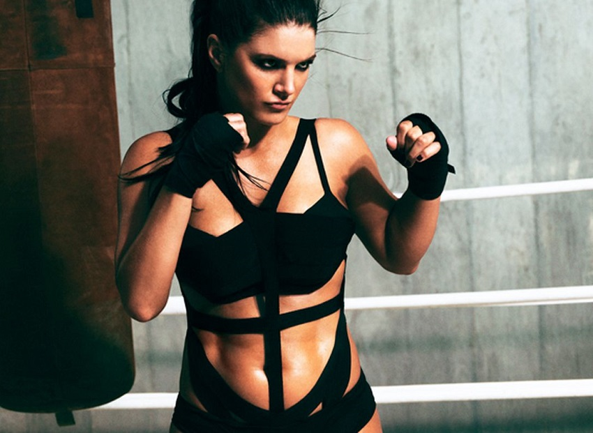Gina Carano posing in a photo shoot, standing in a boxing stance