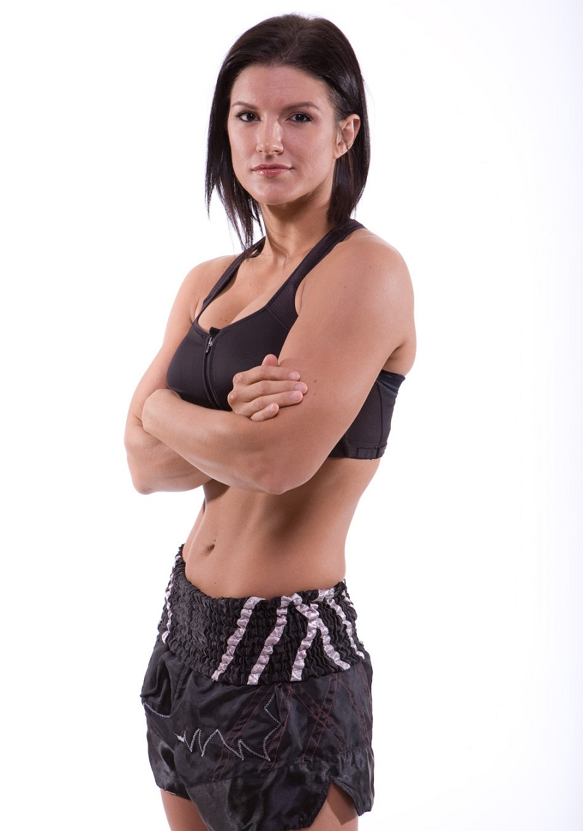 Gina Carano posing in a photo shoot in her boxing outfit looking fit and lean
