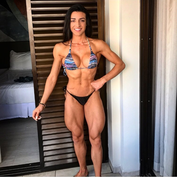 Jessica Basso Ortiz posing for a photo in an exotic bikini looking ripped and muscular