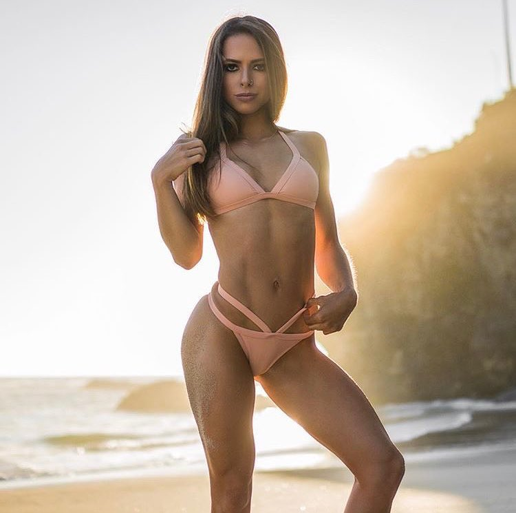 Jade Douglas-Hiley posing for a photo wearing a bikini as the sun shines down on her