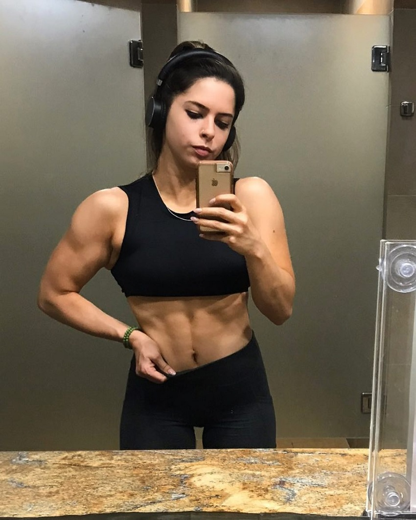 Jade Douglas-Hiley taking a selfie of her ripped abs