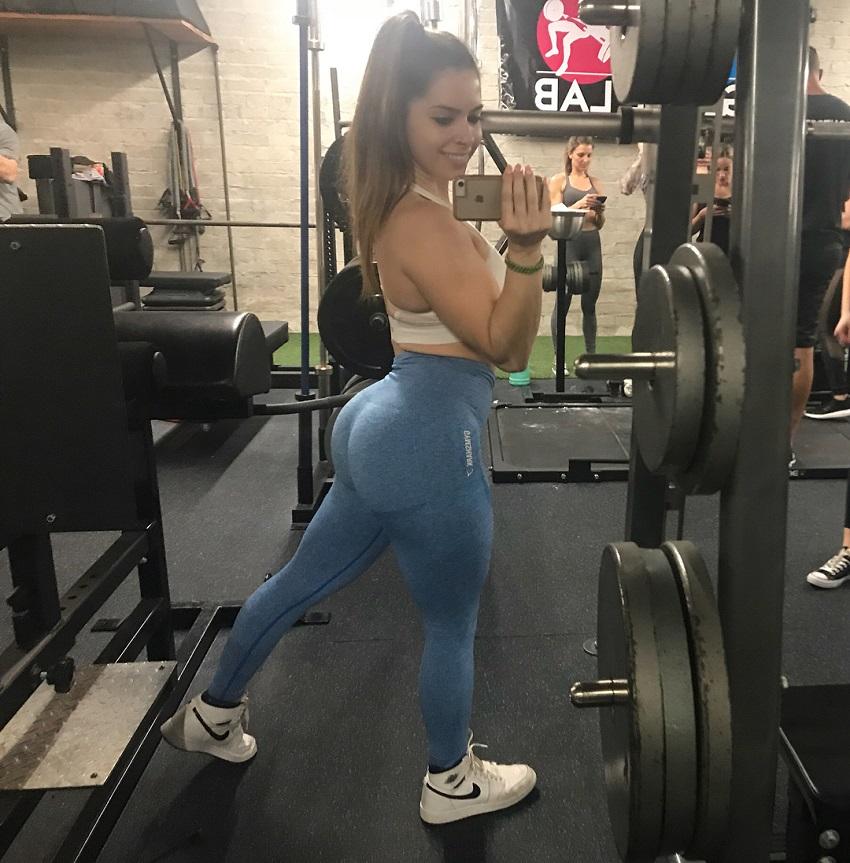 Jade Douglas-Hiley taking a selfie of her curvy figure in the gym