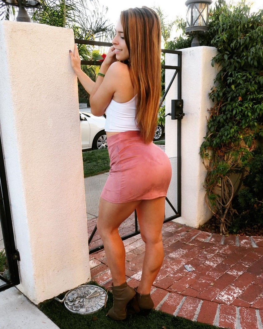 Jade Douglas-Hiley posing in her skirt showing off her curvy physique