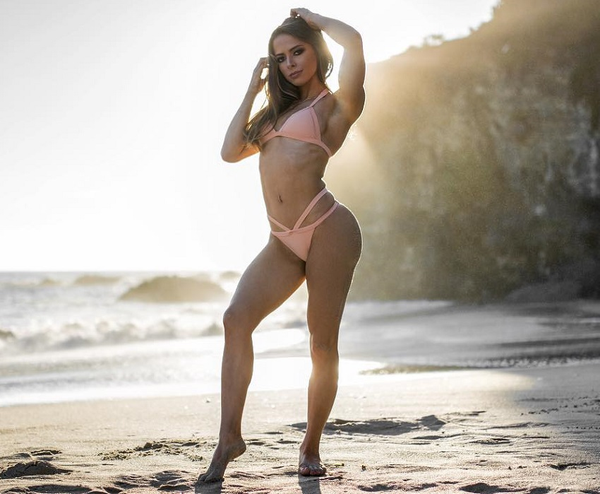 Jade Douglas-Hiley standing on the beach looking fit and lean