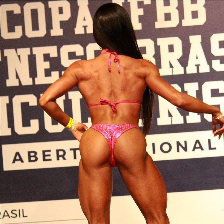 Jessica Basso Ortiz standing on a fitness stage
