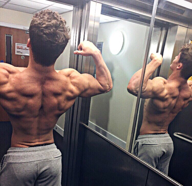 Justin Martilini flexing his shirtless back muscles looking fit and ripped