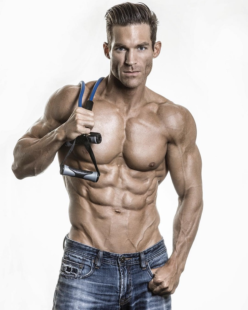 Kyle Clarke posing shirtless in a photo looking ripped and lean