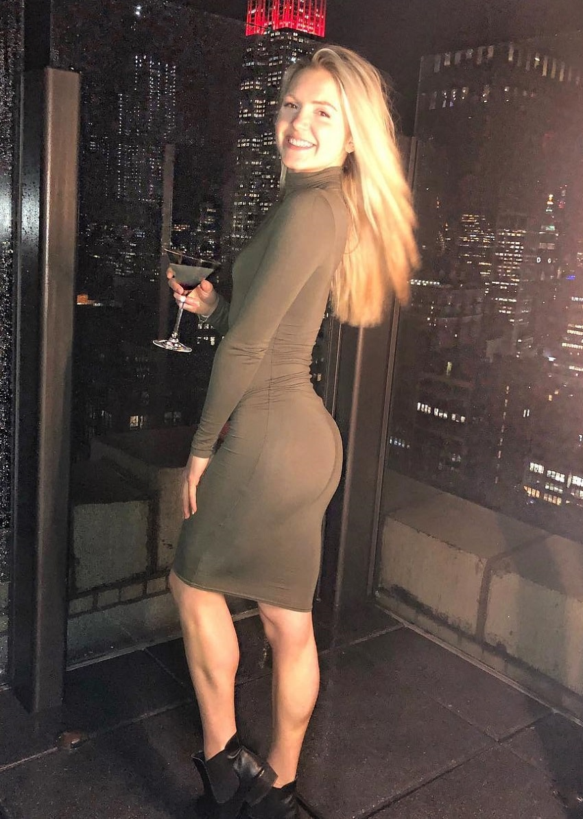 Lauren Tickner wearing a stylish dress looking curvy and fit